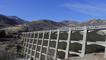 This Thursday, Nov. 7, 2019 photo, shows the Mountain Dell Dam, 5 miles east of Salt Lake City. The window-like arches on the outside of the towering Mountain Dell Dam provide an artistic facade that fits with the natural beauty of the Utah mountain canyon where the century-old structure sits. The dam is listed in poor condition because of deteriorating concrete that allows seepage from the reservoir, said David Marble, Utah assistant state engineer. (AP Photo/Rick Bowmer)