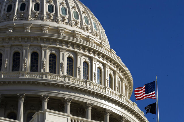 The U.S. flag flies over the U.S. Capitol in Washington, Sunday, Jan. 19, 2020. (AP Photo/Manuel Balce Ceneta)