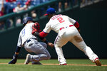 Philadelphia Phillies' Jean Segura (2) tags out San Diego Padres' Luis Urias during the second inning of a baseball game, Sunday, Aug. 18, 2019, in Philadelphia. (AP Photo/Matt Rourke)