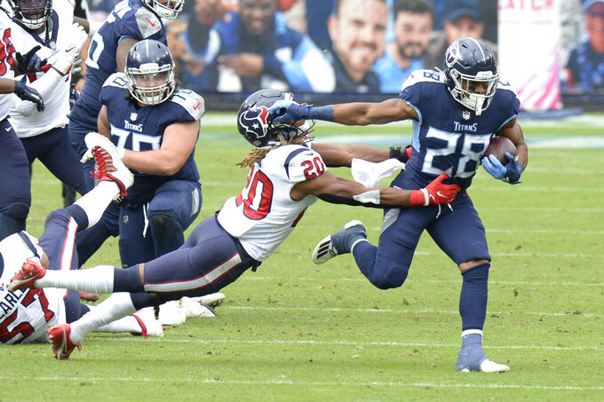 Tennessee Titans running back Jeremy McNichols (28) gets past Houston Texans strong safety Justin Reid (20) in the second half of an NFL football game Sunday, Oct. 18, 2020, in Nashville, Tenn. (AP Photo/Mark Zaleski)