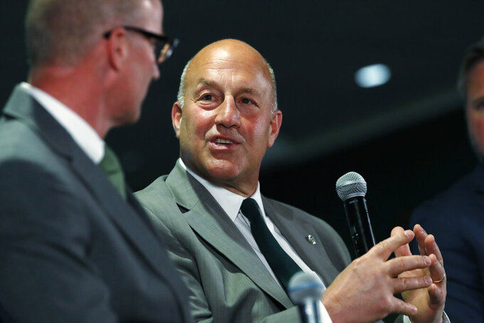 Colorado State head coach Steve Addazio, back, chats with athletic director Joe Parker during an announcement that Addazio has been hired as the new head football coach at a news conference at the school Thursday, Dec. 12, 2019, in Fort Collins, Colo. (AP Photo/David Zalubowski)