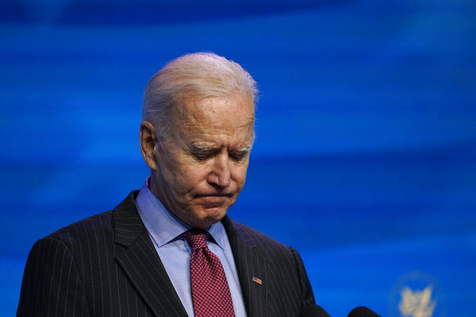 FILE - In this Jan. 8, 2021, file photo President-elect Joe Biden speaks during an event at The Queen theater in Wilmington, Del. When Biden takes office later this month, his biggest challenge may be navigating a deeply divided country past the turmoil of the Trump era. (AP Photo/Susan Walsh, File)