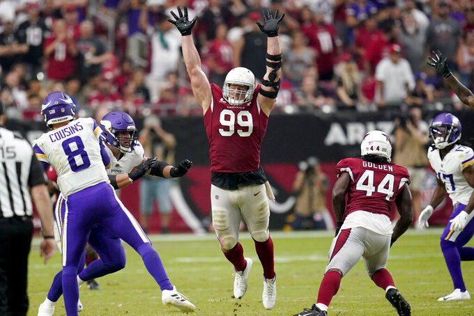 Arizona Cardinals defensive end J.J. Watt (99) defends against the Minnesota Vikings during the second half of an NFL football game, Sunday, Sept. 19, 2021, in Glendale, Ariz. The Cardinals won 34-33. (AP Photo/Ross D. Franklin)