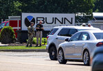 Law enforcement respond to the scene of an active shooter situation at the Bunn-O-Matic warehouse on Stevenson Drive, Friday, June 26, 2020, in Springfield, Ill. Police say officers are searching for a gunman at a warehouse in the Illinois state capital after at least one person was shot and wounded. (Justin L. Fowler/The State Journal-Register via AP)