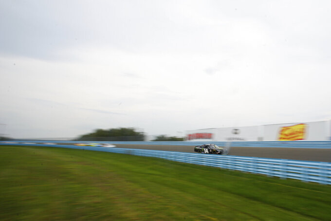 Ty Gibbs (54) leads the pack as he rounds through the esses during the second stage of a NASCAR Xfinity Series auto race at Watkins Glen International in Watkins Glen, N.Y., on Saturday, Aug. 7, 2021. (AP Photo/Joshua Bessex)