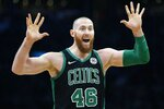 Boston Celtics' Aron Baynes reacts to a call during the first half of an NBA basketball game Houston Rockets in Boston, Sunday, March 3, 2019. (AP Photo/Michael Dwyer)