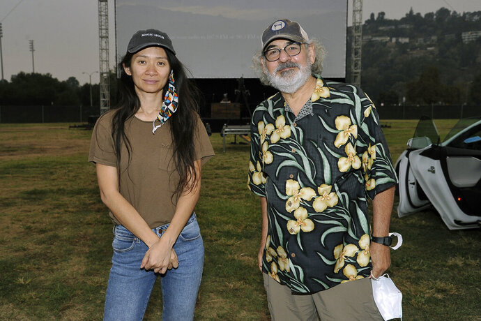 Chloe Zhao, left, and Stephen Gilula attend the Telluride from Los Angeles drive-in screening of