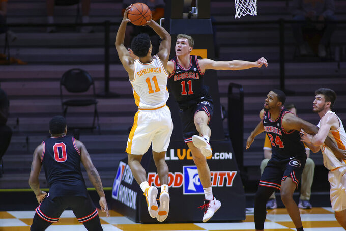 Tennessee guard Jaden Springer, left, shoots against Georgia's Jaxon Etter, right, during an NCAA college basketball game Wednesday, Feb. 10, 2021, in Knoxville, Tenn., in Knoxville, Tenn. (Randy Sartin/Pool Photo via AP)