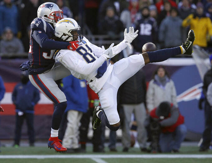 New England Patriots defensive back Devin McCourty, left, breaks up a pass intended for Los Angeles Chargers wide receiver Mike Williams during the first half of an NFL divisional playoff football game, Sunday, Jan. 13, 2019, in Foxborough, Mass. (AP Photo/Charles Krupa)