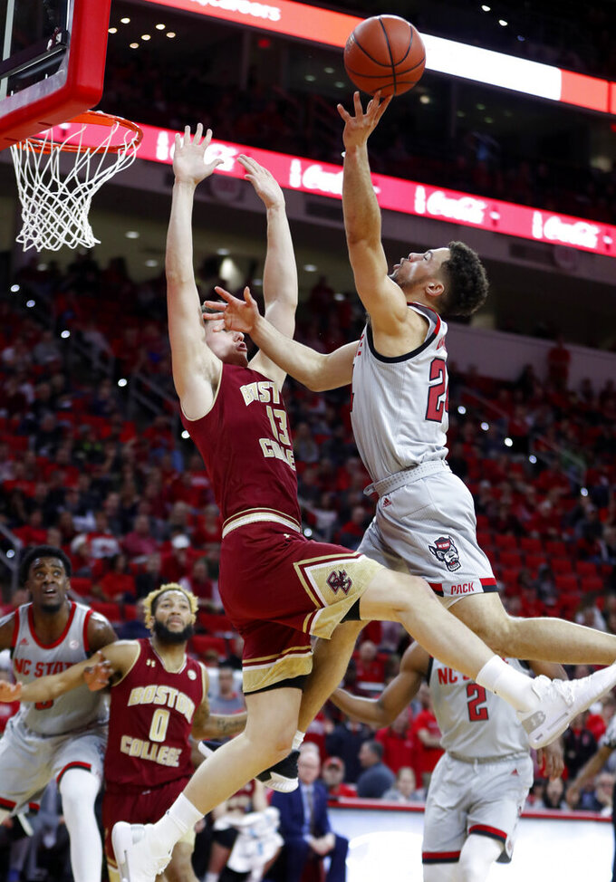 North Carolina State's Devon Daniels (24) shoots as Boston College's Luka Kraljevic (13) defends during the first half of an NCAA college basketball game in Raleigh, N.C., Wednesday, Feb. 20, 2019. (Ethan Hyman/The News & Observer via AP)