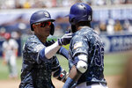 San Diego Padres' Manny Machado, left, reacts with teammate Franmil Reyes after hitting a two-run home run during the first inning of a baseball game against the St. Louis Cardinals, Sunday, June 30, 2019, in San Diego. (AP Photo/Gregory Bull)