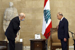 """In this photo released by Lebanon's official government photographer Dalati Nohra, French Foreign Minister Jean-Yves Le Drian, left, and Lebanese President Michel Aoun, greet each other at the Presidential Palace in Baabda, east of Beirut, Lebanon, Thursday, May 6, 2021. Le Drian began a visit to Lebanon Thursday with a message of """"great firmness"""" to its political leaders, threatening to take additional measures against officials obstructing the formation of a government in the crisis-hit country. (Dalati Nohra via AP)"""