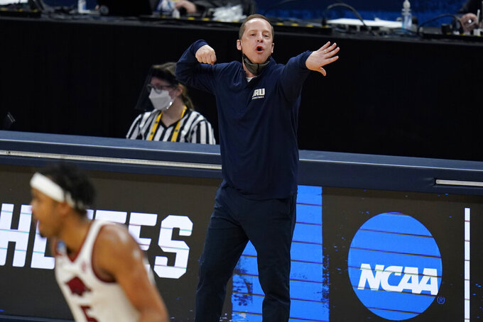 Oral Roberts head coach Paul Mills directs his team during the second half of a Sweet 16 game against Arkansas in the NCAA men's college basketball tournament at Bankers Life Fieldhouse, Saturday, March 27, 2021, in Indianapolis. (AP Photo/Jeff Roberson)