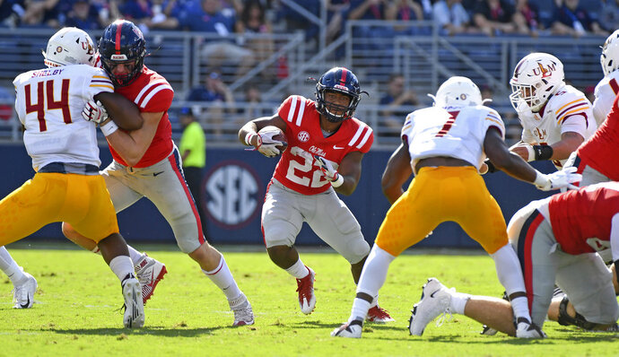 Mississippi running back Scottie Phillips (22) runs the ball during the first half of an NCAA college football game against Louisiana Monroe in Oxford, Miss., Saturday, Oct. 6, 2018. (AP Photo/Thomas Graning)