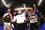 In a photo provided by Showtime, Claressa Shields, right, celebrates after a win over Tori Nelson during a boxing bout Friday night, Jan. 12, 2018, in Verona, N.Y. Shields scored a unanimous 10-round decision to retain her women's WBC and IBF super middleweight world titles. (Stephanie Trapp/Showtime via AP)
