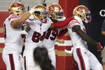 San Francisco 49ers wide receiver Brandon Aiyuk, right, celebrates with teammates after scoring against the Los Angeles Rams during the first half of an NFL football game in Santa Clara, Calif., Sunday, Oct. 18, 2020. (AP Photo/Tony Avelar)