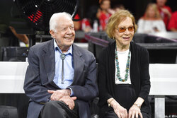 FILE- In this Sept. 30, 2018 file photo, former President Jimmy Carter and Rosalynn Carter are seen ahead of an NFL football game between the Atlanta Falcons and the Cincinnati Bengals, in Atlanta. Former President Carter turns 95 on Tuesday, Oct. 1, 2019. (AP Photo/John Amis, File)