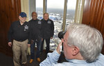 With the Mercedes-Benz Stadium in the background, members of the Never Miss a Super Bowl Club, from left, Tom Henschel, Gregory Eaton and Don Crisman pose for a group photograph during a welcome luncheon in Atlanta on Friday, Feb. 1, 2019. (Hyosub Shin/Atlanta Journal-Constitution via AP)