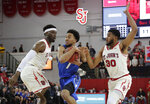 Creighton's Davion Mintz (1) drives past St. John's Sedee Keita (0) and LJ Figueroa (30) during the first half of an NCAA college basketball game Wednesday, Jan. 16, 2019, in New York. (AP Photo/Frank Franklin II)