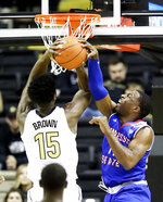 Vanderbilt forward Clevon Brown (15) shoots against Tennessee State guard Kamar McKnight in the first half of an NCAA college basketball game Saturday, Dec. 29, 2018, in Nashville, Tenn. (AP Photo/Mark Humphrey)