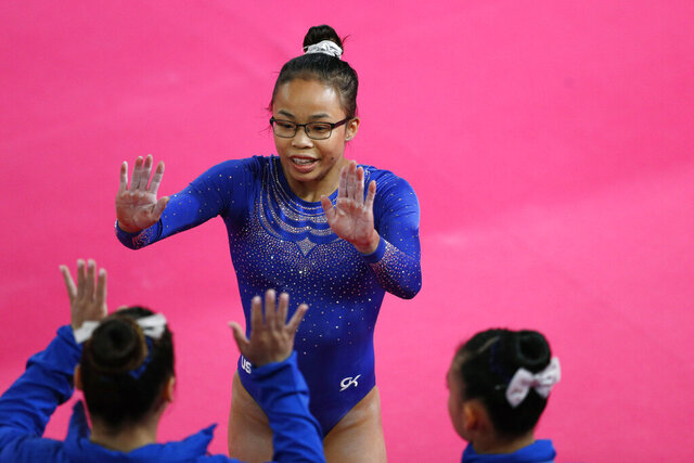 FILE - In this July 27, 2019, file photo, Morgan Hurd is congratulated by teammates after competing in the women's gymnastics qualification and team final at the Pan American Games in Lima, Peru. Hurd has arguably spent the last three years as the best gymnast in the world not named Simone Biles. The 2017 world champion, however has work to do to assure herself of an Olympic spot. The journey begins in earnest on Saturday at the American Cup.  (AP Photo/Rebecca Blackwell, File)