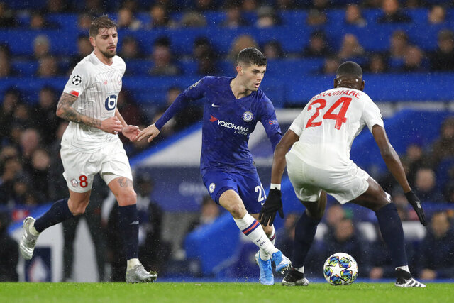 Chelsea's Christian Pulisic fights for the ball against Lille's Boubakary Soumare during the Champions League Group H soccer match between Chelsea and Lille at Stamford Bridge stadium in London Tuesday, Dec. 10, 2019. (AP Photo/Kirsty Wigglesworth)