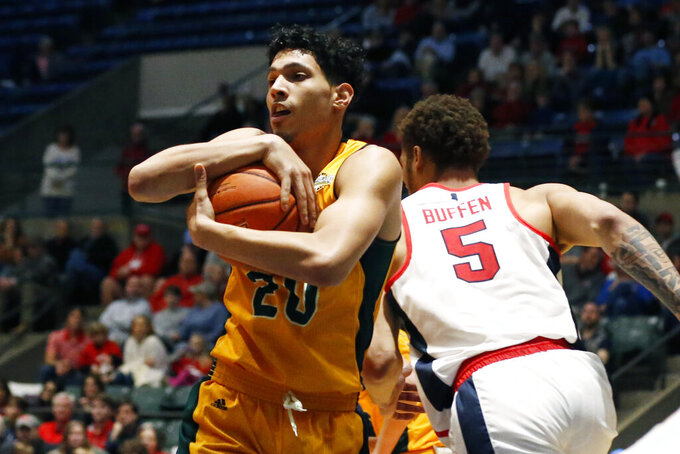 Southeastern Louisiana forward Brandon Gonzalez (20) holds on to a rebound as Mississippi forward KJ Buffen (5) rushes past during the second half of an NCAA college basketball game, Saturday, Dec. 21, 2019, in Jackson, Miss. Mississippi won 83-76.(AP Photo/Rogelio V. Solis)