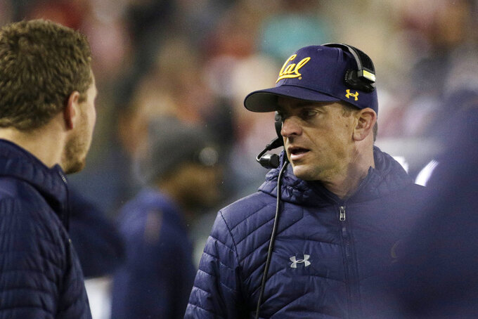 California head coach Justin Wilcox, right, speaks with his staff during the first half of an NCAA college football game against Washington State in Pullman, Wash., Saturday, Nov. 3, 2018. (AP Photo/Young Kwak)