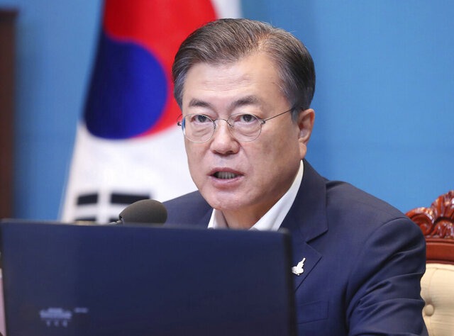 South Korean President Moon Jae-in speaks during a meeting with his senior secretaries at the presidential Blue House in Seoul, South Korea, Monday, Sept. 28, 2020. (Lee Jin-wook/Yonhap via AP)