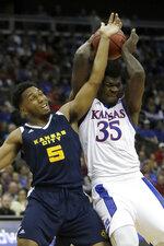 Kansas center Udoka Azubuike (35) rebounds against Kansas City forward Jordan Giles (5) during the first half of an NCAA college basketball game in Kansas City, Kan., Saturday, Dec. 14, 2019. (AP Photo/Orlin Wagner)