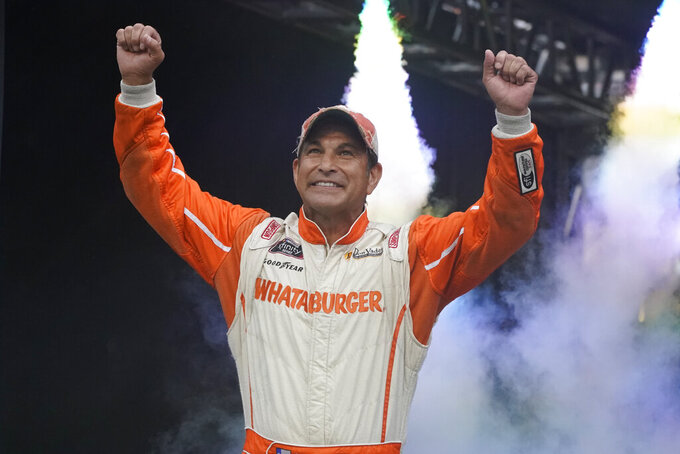 David Starr waves to fans before a NASCAR Cup Series auto race at Bristol Motor Speedway Saturday, Sept. 18, 2021, in Bristol, Tenn. (AP Photo/Mark Humphrey)
