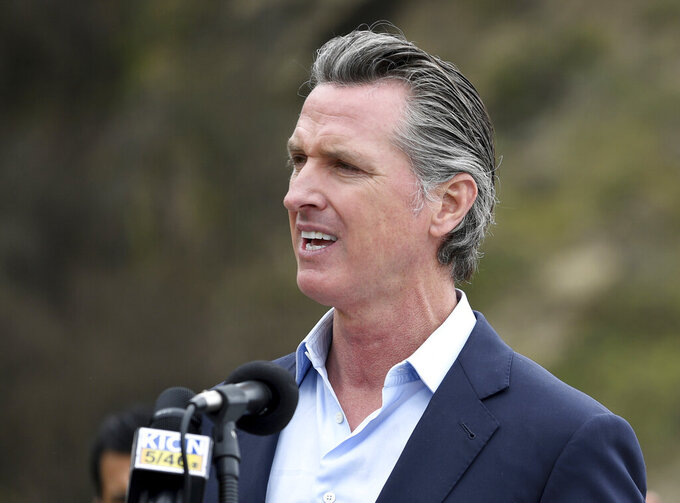 FILE - In this April 23, 2021, file photo, California Gov. Gavin Newsom speaks during a press conference in Big Sur, Calif. The state's population has become a political issue this year in light of the effort to recall Newsom, with Republicans blaming high taxes and the governor's policies for people fleeing the state. (AP Photo/Nic Coury, File)