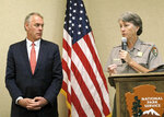 FILE - In this Oct. 13, 2017, file photo, then-Interior Secretary Ryan Zinke, left, and Grand Canyon National Park Superintendent Christine Lehnertz address National Park Service employees at Grand Canyon National Park, Ariz. Lehnertz is returning to work after being cleared in a federal investigation. (AP Photo/Felicia Fonseca, File)