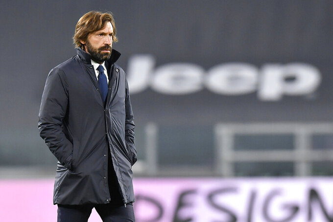 Juventus coach Andrea Pirlo walks on the pitch prior to the Serie A soccer match between Juventus and Hellas Verona, at the Allianz Stadium in Turin, Italy, Sunday, Oct. 25, 2020. (Tano Pecoraro/LaPresse via AP)
