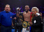 Julian Williams smiles after defeating Jarrett Hurd for the IBF, WBA and IBO super welterweight boxing titles in Fairfax, Va., Saturday, May 11, 2019. Williams won by unanimous decision. (AP Photo/Jose Luis Magana)