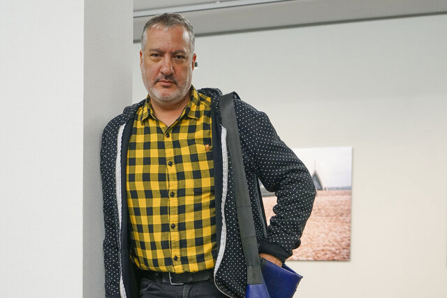 This photo taken Oct. 3, 2019 shows artist Spencer Tunick, a photographer known internationally for his shoots assembling masses of nude people, at the FLATZ Museum in Dornbirn, Austria. The unclothed human body accounts for the bulk of the material Facebook removes from its service and activists, sex therapists, artists and sex educators say the company is unfairly censoring their work, suspending them in