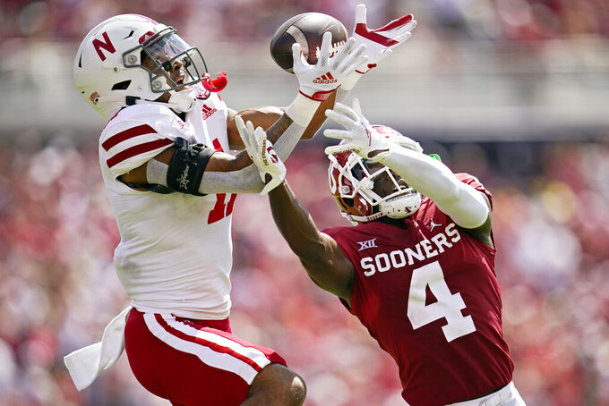 Nebraska cornerback Braxton Clark (11) breaks up a pass intended for Oklahoma wide receiver Mario Williams (4) in the second half of an NCAA college football game, Saturday, Sept. 18, 2021, in Norman, Okla. (AP Photo/Sue Ogrocki)