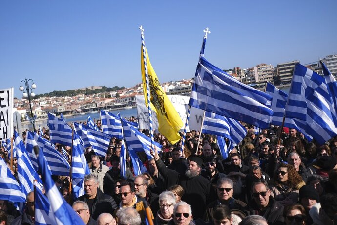 Protesters take part in a rally outside the Municipality of Mytilene, on the northeastern Aegean island of Lesbos, Greece, on Wednesday, Jan. 22, 2020. Local residents and business owners have launched a day of protest on the Greek islands hardest hit by migration, demanding the Greek government ease severe overcrowding at refugee camps. (AP Photo/Aggelos Barai)