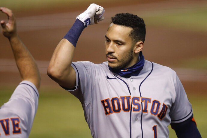 Houston Astros Carlos Correa (1) celebrates his solo home run against the Arizona Diamondbacks during the second inning of a baseball game Tuesday, Aug. 4, 2020, in Phoenix. (AP Photo/Matt York)