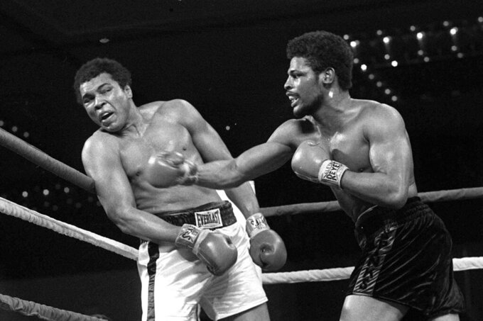 FILE - In this Feb. 15, 1978, file photo, Leon Spinks, right, connects with a right hook to Muhammad Ali, during the late rounds of their championship fight in Las Vegas. Former heavyweight champion Leon Spinks Jr. died Friday night, Feb. 5, 2021, after battling prostate and other cancers. He was 67. (AP Photo/File)