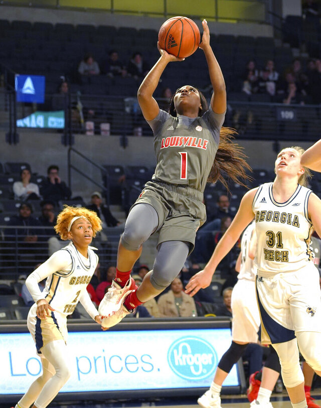 Louisville forward Ramani Parker(1) shoots for a basket past Georgia Tech defenders Jasmine Carson (2) and Lotta Maj-Lahtinen (31) during the first half of an NCAA college basketball game Thursday, Feb. 20, 2020, in Atlanta, Ga(AP Photo/Tami Chappell)
