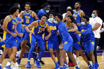 Pittsburgh's Justin Champagnie, left, celebrates with teammates after Pittsburgh win over Northwestern in an NCAA college basketball game in Evanston, Ill., Wednesday, Dec. 9, 2020. (AP Photo/Nam Y. Huh)