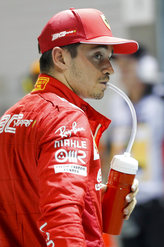 Ferrari driver Charles Leclerc of Monaco takes a drink after taking pole position in the qualifying session for the Singapore Formula One Grand Prix at the Marina Bay City Circuit in Singapore, Saturday, Sept. 21, 2019. (AP Photo/Vincent Thian)