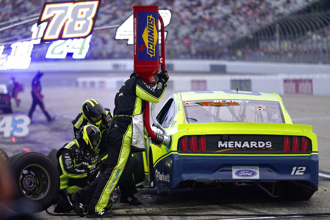 Ryan Blaney makes a pit stop during the NASCAR Cup Series auto race, Sunday, July 18, 2021, in Loudon, N.H. (AP Photo/Charles Krupa)