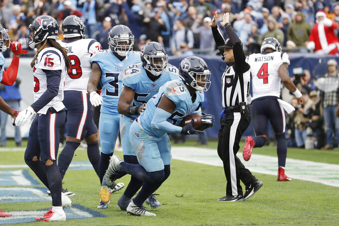 Tennessee Titans inside linebacker Jayon Brown (55) celebrates after he intercepted a pass in the end zone against the Houston Texans in the second half of an NFL football game Sunday, Dec. 15, 2019, in Nashville, Tenn. (AP Photo/James Kenney)