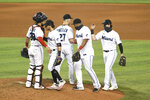 Miami Marlins celebrate after the team's baseball game against the Washington Nationals, Sunday, Sept. 20, 2020, in Miami. (AP Photo/Gaston De Cardenas)