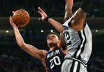New York Knicks forward Kevin Knox (20) looks for a shot around the defense of San Antonio Spurs center LaMarcus Aldridge (12) during the first half of an NBA basketball game in New York, Sunday, Feb. 24, 2019. (AP Photo/Kathy Willens)
