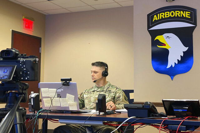 U.S. Army Maj. Evan Adams pitches his idea of a new mobile app to manage training areas on bases in real time on Tuesday, Oct. 27, 2020, at Fort Campbell, Ky. Adams, who is assigned to the 101st Airborne Division, won round one of the competition. The Shark Tank like competition is aimed at sourcing new ideas from untapped areas of the Army. (U.S. Army via AP)