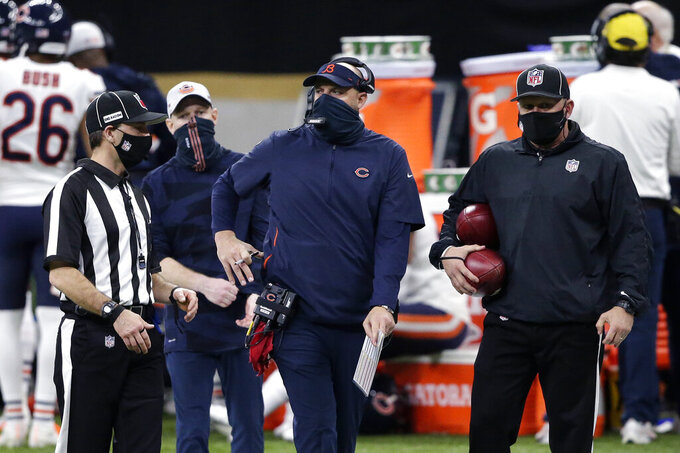 Chicago Bears head coach Matt Nagy talks to an official in the first half of an NFL wild-card playoff football game against the New Orleans Saints in New Orleans, Sunday, Jan. 10, 2021. (AP Photo/Butch Dill)