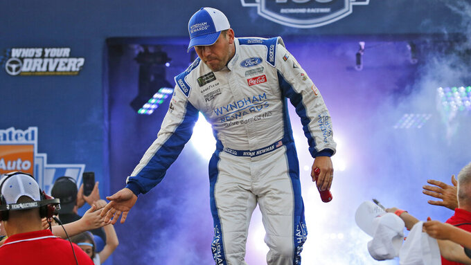 Ryan Newman greets fans during driver introductions for the NASCAR Monster Energy Cup series auto race at Richmond Raceway in Richmond, Va., Saturday, Sept. 21, 2019. (AP Photo/Steve Helber)
